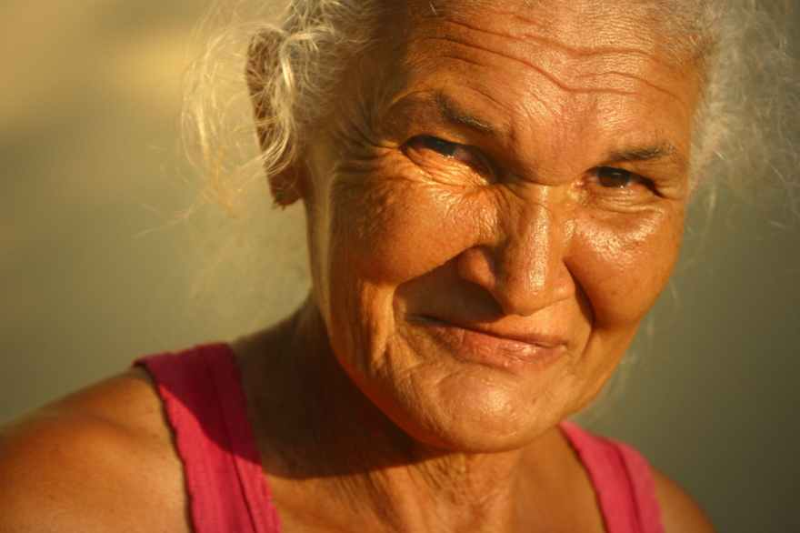 close-up of older woman's face in golden sunlight