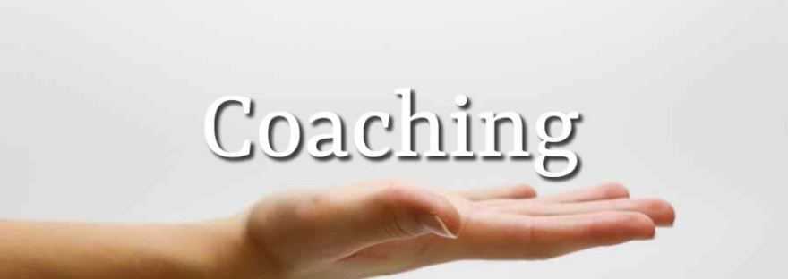 An outstretched hand with a text label which says Coaching