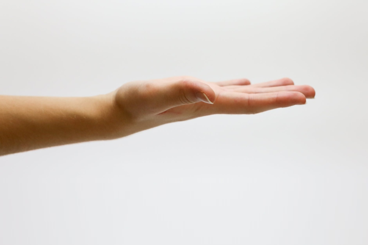 A hand outstretched, facing upwards