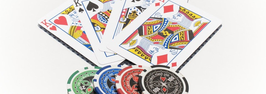 playing cards - four kings - and poker tokens